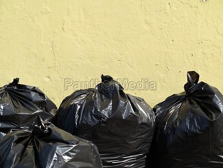 pile of black garbage bags full