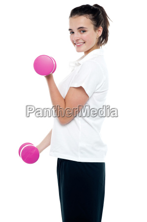 side pose of girl with dumbbells