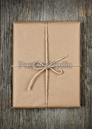 gift in brown paper tied with