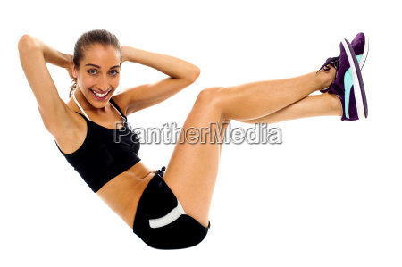fit woman in sporty attire doing