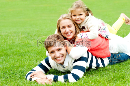 husband wife and child piled on