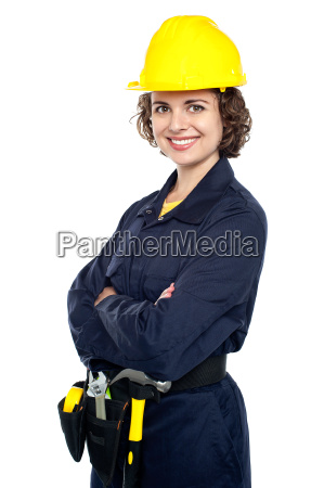cheerful young worker in jumpsuit