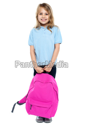 little schoolgirl posing with pink backpack