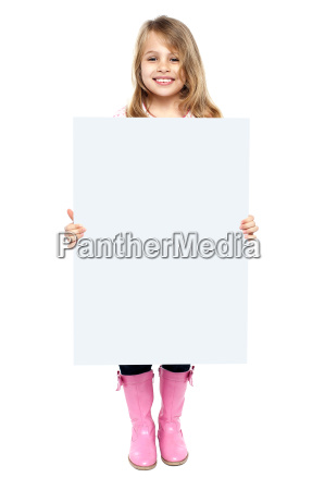 an adorable kid showing blank whiteboard