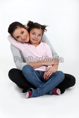 a mother and her daughter hugging