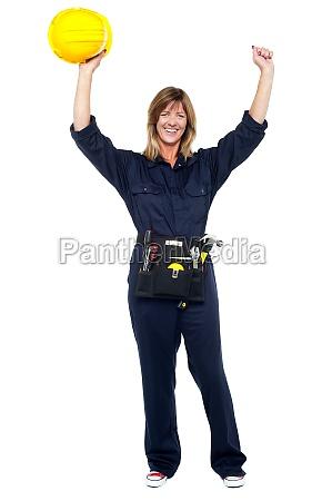 jubilant female architect celebrating success