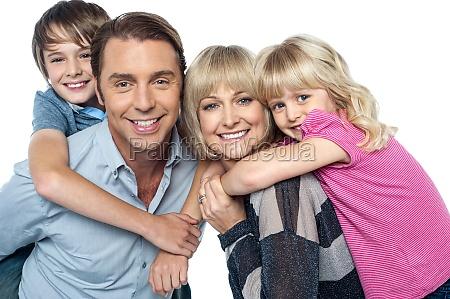 happy family of four members posing