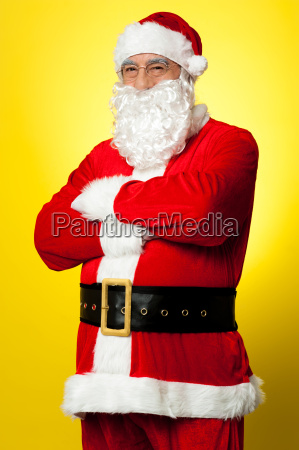 confident male santa posing with arms