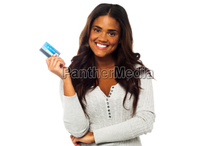 young woman holding up a credit