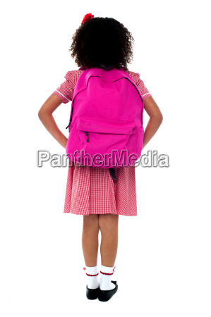 primary school girl facing wall