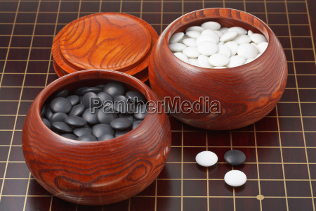 go game stones and wooden bowls