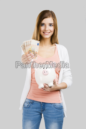 beautiful woman putting money in a
