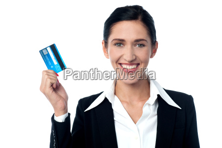 attractive business lady showing credit card