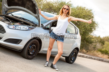attractive blond woman at a road