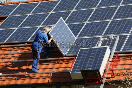 workman is mounting solar panel