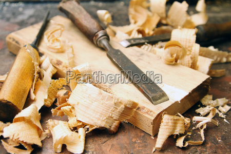 old wood chisels with shavings on