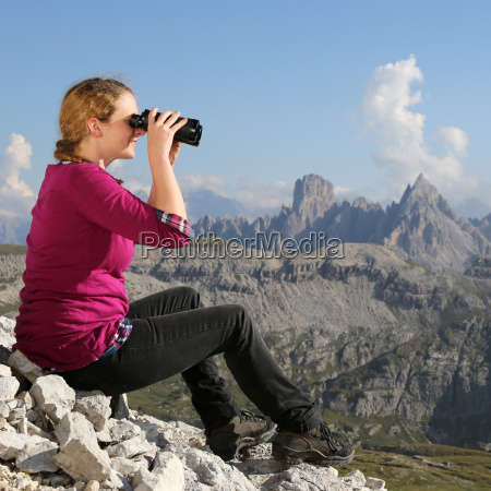 young woman looks at the landscape