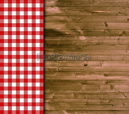 wood background and tablecloth with red
