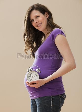 anticipation pregnant new life alarm clock