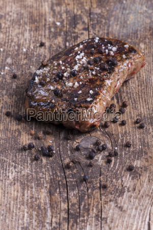 grilled steak with pepper and salt