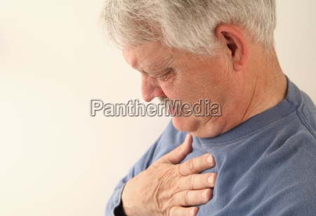 senior suffers from heartburn or chest