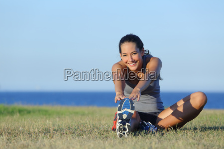 fitness runner woman stretching on the