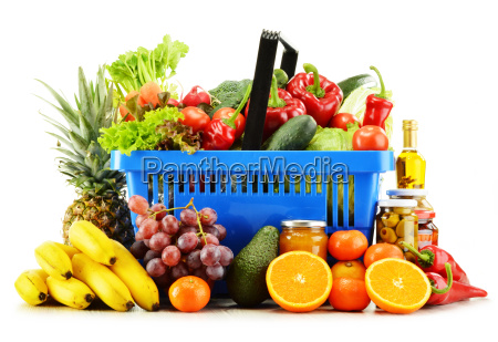 plastic shopping basket with groceries isolated