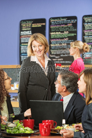 business people in cafe talking