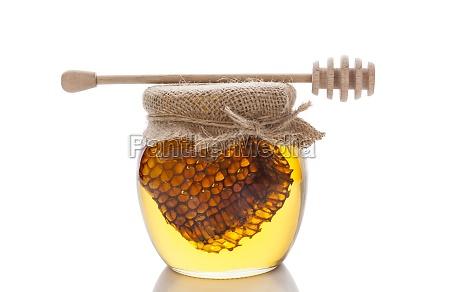 honey in glass on white