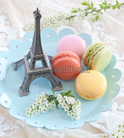 colorful macaraons on a blue plate