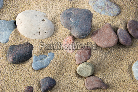 untouched sandy beach with pebbles