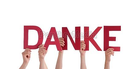 people holding red danke
