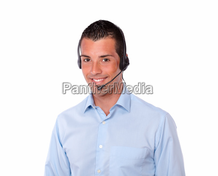 cute young guy speaking with earphone