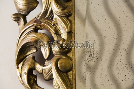 detail ornate tarnished mirror