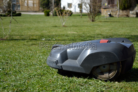 lawn mower is on the road