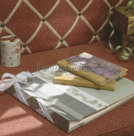 scrapbook and journals with glasses on