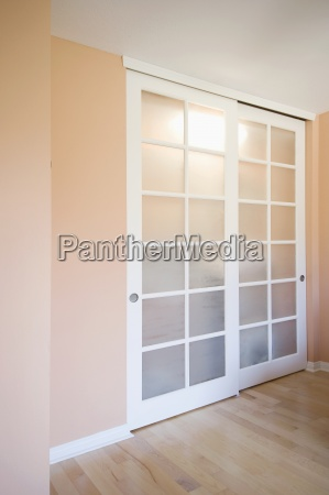 sliding closet doors in peach colored