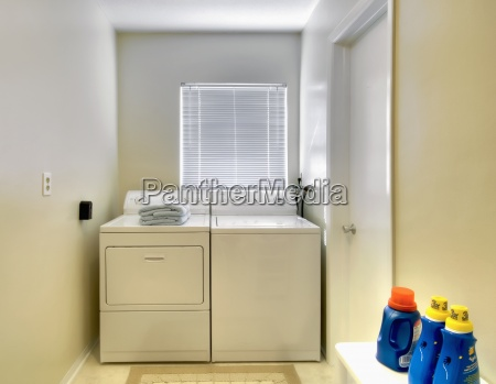 white laundry room in traditional home