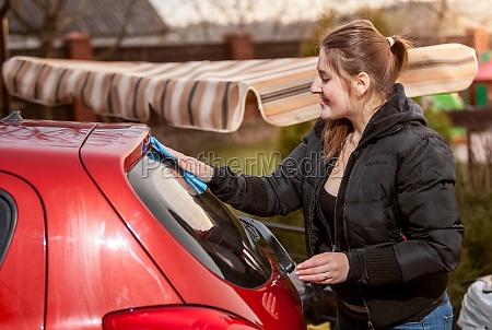 portrait of brunette woman washing red