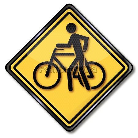 sign cycling and pushing bike