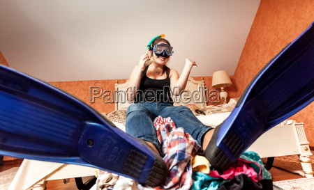 woman in flippers and mask sitting