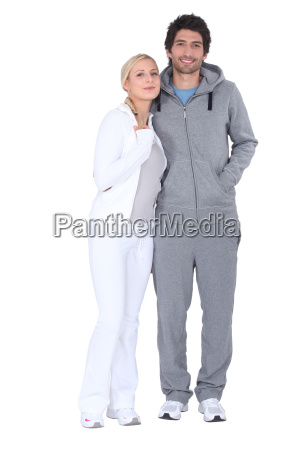 a couple wearing sport suits