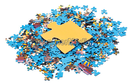 big yellow piece on pile of