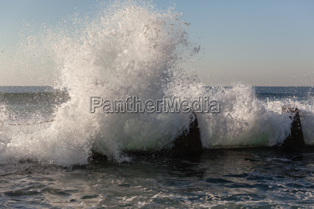 wave crashing white water tidal pool