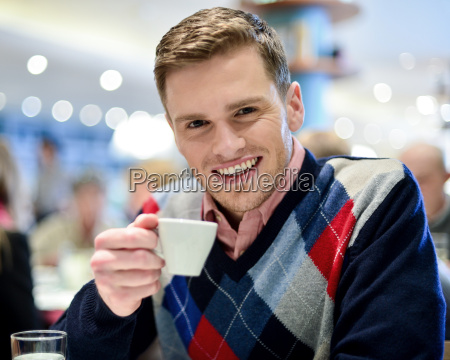 casual man in cafe with coffee