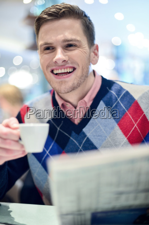 stylish man drinking a coffee at