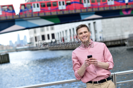 handsome man texting on a mobile