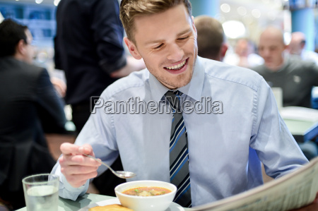 smiling young businessman in a restaurant