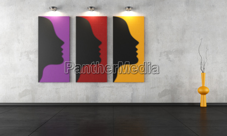 three contemporary paintings in a empty