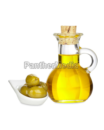 carafe with olive oil and olives